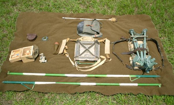 60mm M57 Bipod Pack, Spade Pack, NSB-3 Sight, Quadrant, Aiming Stakes, Cleaning Kit and HE Round