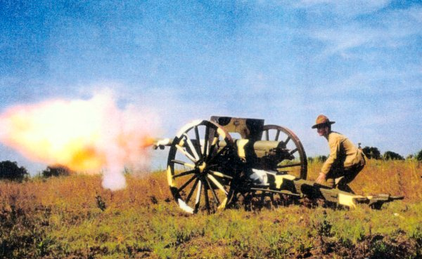 "75 mm mle 1897 ""French 75mm"" being fired by Ralph Lovett in a pre-WW I US uniform for artillery"